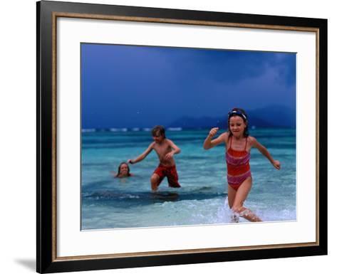Children Running Out of Ocean in Stormy Weather, Seychelles-Philip & Karen Smith-Framed Art Print