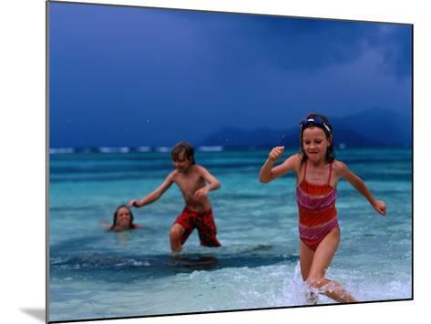 Children Running Out of Ocean in Stormy Weather, Seychelles-Philip & Karen Smith-Mounted Photographic Print