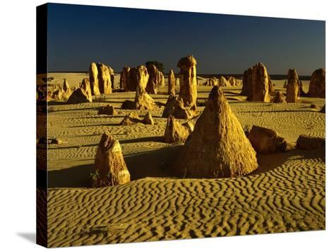 Rock Formations in the Sand of the Pinnacles Desert, Nambung National Park, Western Australia-Richard I'Anson-Stretched Canvas Print