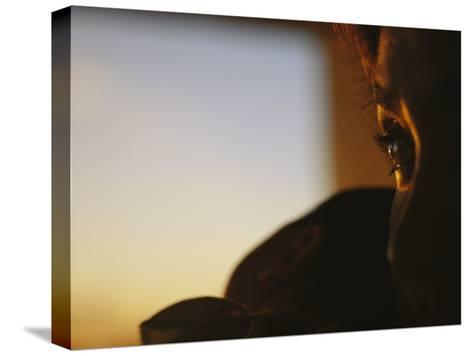 Close View of a Womans Profile Shadowed in the Late Afternoon Light-Raul Touzon-Stretched Canvas Print