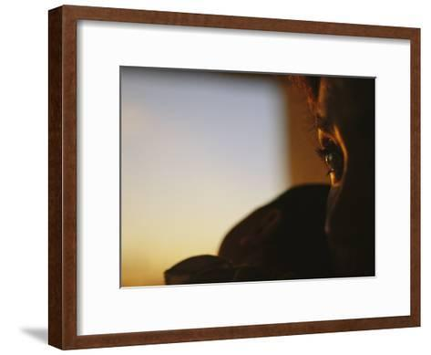 Close View of a Womans Profile Shadowed in the Late Afternoon Light-Raul Touzon-Framed Art Print