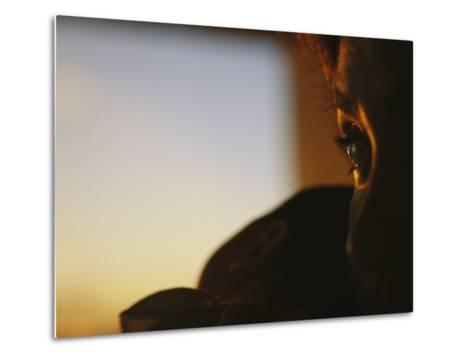 Close View of a Womans Profile Shadowed in the Late Afternoon Light-Raul Touzon-Metal Print