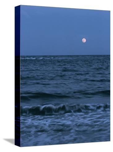 A Twilight Shot of Waves Coming into Shore with the Moon in the Background-Ira Block-Stretched Canvas Print