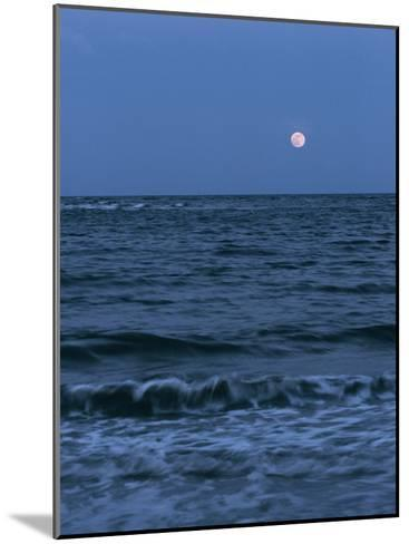 A Twilight Shot of Waves Coming into Shore with the Moon in the Background-Ira Block-Mounted Photographic Print