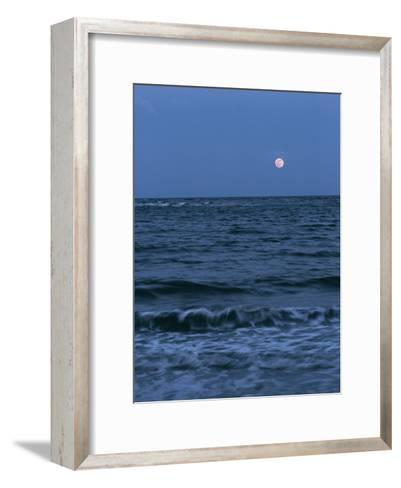 A Twilight Shot of Waves Coming into Shore with the Moon in the Background-Ira Block-Framed Art Print