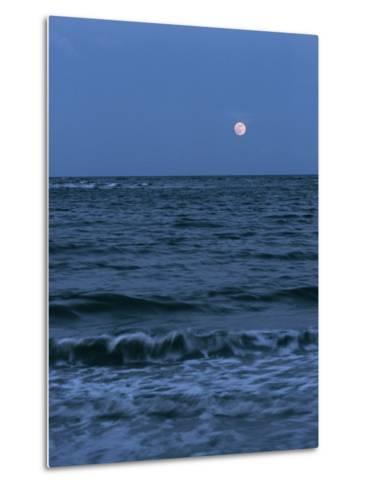 A Twilight Shot of Waves Coming into Shore with the Moon in the Background-Ira Block-Metal Print