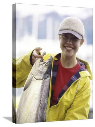 Teen Girl Holding a Fish--Stretched Canvas Print