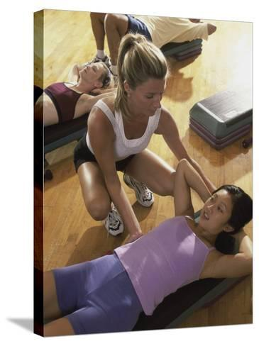 High Angle View of a Group of People Exercising in a Step Aerobics Class--Stretched Canvas Print
