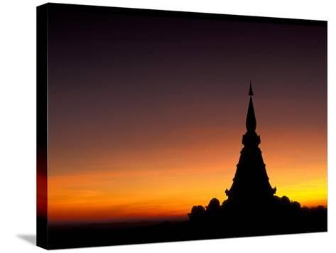 Sunset Sillouhette of Buddhist Temple, Thailand-John & Lisa Merrill-Stretched Canvas Print