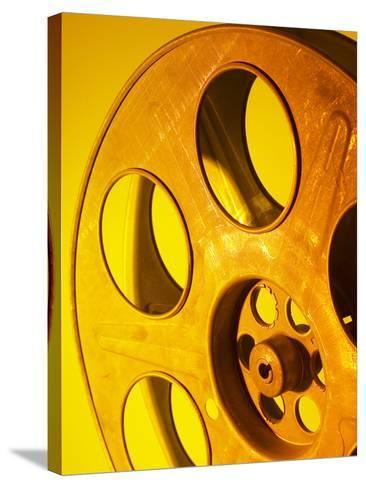 Movie Film and Reels in Yellow Light--Stretched Canvas Print