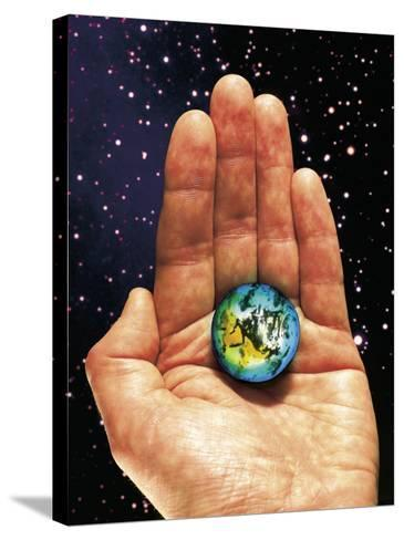 Hand Holding the World-Terry Why-Stretched Canvas Print