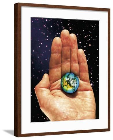Hand Holding the World-Terry Why-Framed Art Print