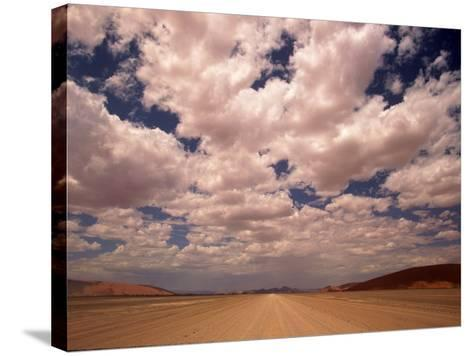 Clouds Over the Namib Desert, Namibia-Walter Bibikow-Stretched Canvas Print