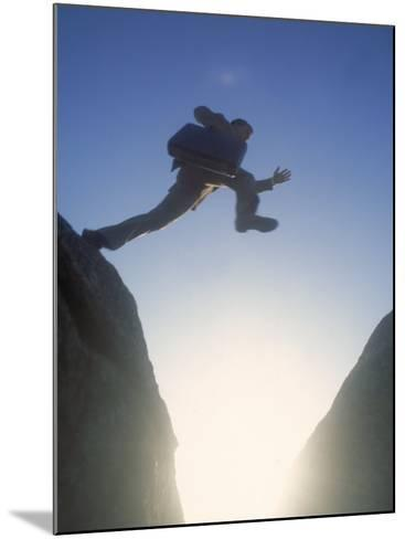 Business Man Leaping Across-Kevin Leigh-Mounted Photographic Print