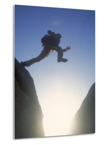 Business Man Leaping Across-Kevin Leigh-Metal Print