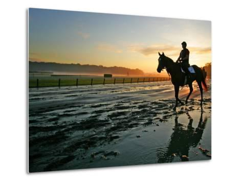 An Unidentified Horse and Rider on the Track at Sunrise at Belmont Park--Metal Print