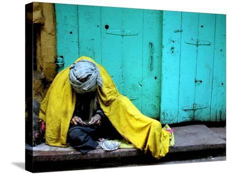 A Muslim Man Warms Himself--Stretched Canvas Print