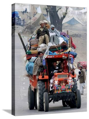 A Pakistan Earthquake Survivor Family Ride a Vehicle as They Make Their Way to Mansehra--Stretched Canvas Print