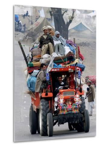 A Pakistan Earthquake Survivor Family Ride a Vehicle as They Make Their Way to Mansehra--Metal Print