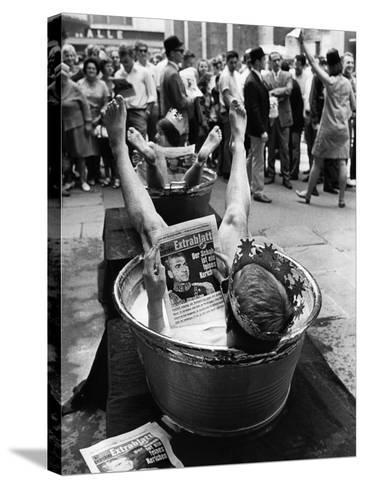 "Protesters Sit in Bath Tubs and Read the Satirical Newspaper ""Pardon""--Stretched Canvas Print"