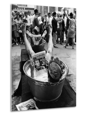 "Protesters Sit in Bath Tubs and Read the Satirical Newspaper ""Pardon""--Metal Print"