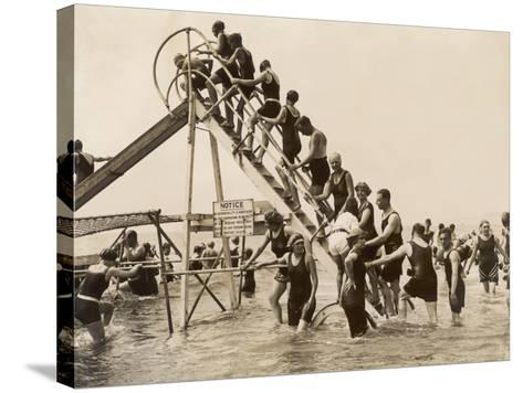 Bathers at Bournemouth Wait Their Turn for a Go on the Water Chute--Stretched Canvas Print