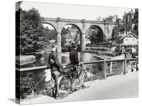 Two Cyclists Take a Break on a Bridge Over the River Nidd at Knaresborough-Fred Musto-Stretched Canvas Print