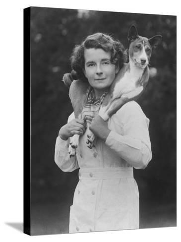 Mrs Tudor-Williams with One of Her Basenjis Kwango of the Congo-Thomas Fall-Stretched Canvas Print