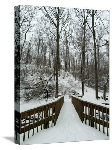 Snow Covered Wooden Bridge Over a Park Stream-Todd Gipstein-Stretched Canvas Print