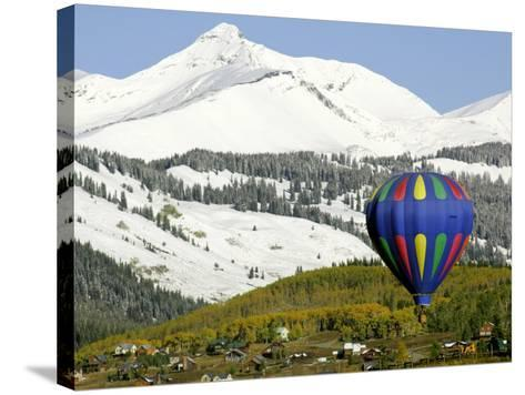 One of the Twelve Hot Air Balloons Takes Flight at Mount Crested Butte, Colorado--Stretched Canvas Print