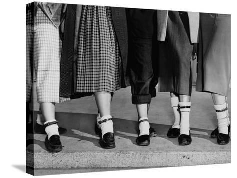 Legs and Feet with Dog Collar Anklets-Roger Higgins-Stretched Canvas Print