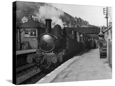 People Board a Steam Train Waiting in the Station--Stretched Canvas Print