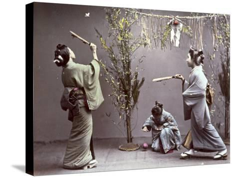 Young Geishas in Traditional Costume Playing 'Hanetuki'--Stretched Canvas Print