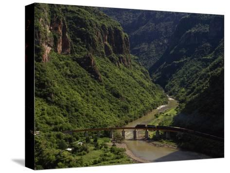 Train Crosses a Bridge at Temoris in Mexico's Copper Canyon Region, Chihuahua State, Mexico-Phil Schermeister-Stretched Canvas Print