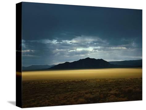 The Setting Sun Permeates Rain Clouds to Brighten Black Rock Desert, Nevada-James P^ Blair-Stretched Canvas Print