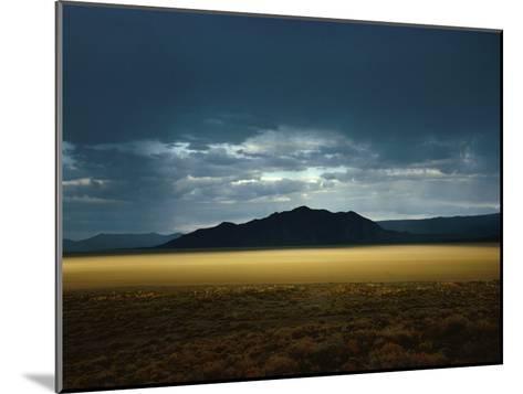 The Setting Sun Permeates Rain Clouds to Brighten Black Rock Desert, Nevada-James P^ Blair-Mounted Photographic Print