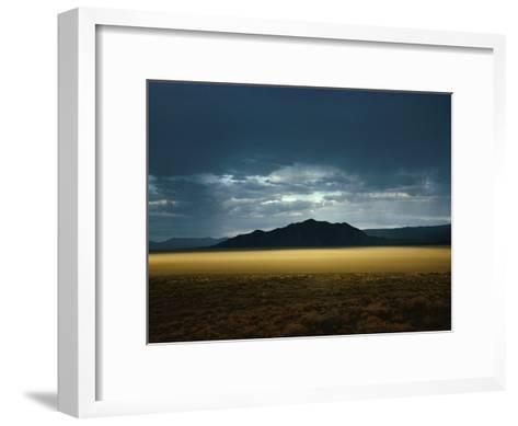 The Setting Sun Permeates Rain Clouds to Brighten Black Rock Desert, Nevada-James P^ Blair-Framed Art Print
