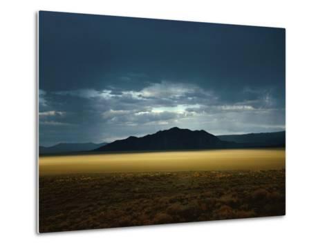The Setting Sun Permeates Rain Clouds to Brighten Black Rock Desert, Nevada-James P^ Blair-Metal Print