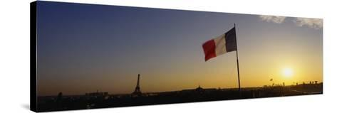 French Flag Waving in the Wind, Paris, France--Stretched Canvas Print