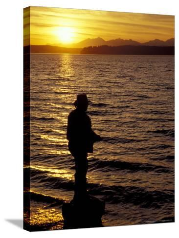 Silhouette of Fisherman at Lincoln Park, Seattle, Washington, USA-William Sutton-Stretched Canvas Print