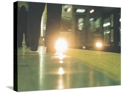 Person Walking Along Subway Platform--Stretched Canvas Print