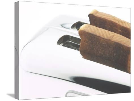 Toast Popping out of Sleek Stainless Steel Toaster--Stretched Canvas Print
