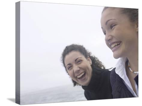 Giggling Women Standing on Edge of Water--Stretched Canvas Print