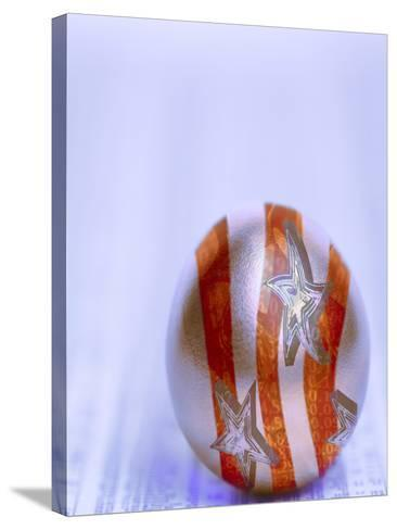 Stars and Stripes Golden Egg Resting on Financial Section of Newspaper--Stretched Canvas Print