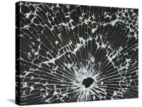 Close-up of a Hole in Cracked and Shattered Glass--Stretched Canvas Print