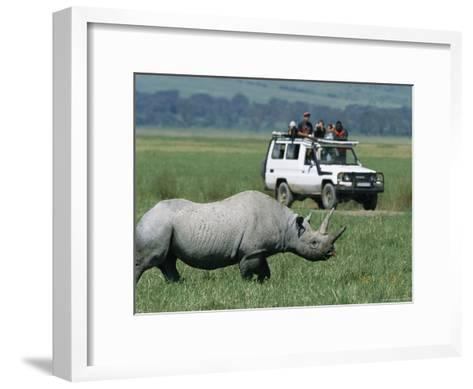 Tourists View a Rhinoceros from a Safari Jeep-Richard Nowitz-Framed Art Print
