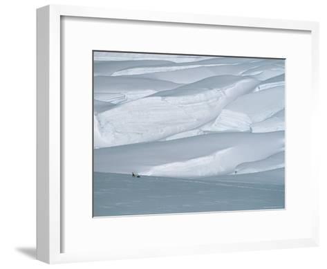 Climber in Denali Is Dwarfed by the Surrounding Snowy Landscape-Bill Hatcher-Framed Art Print
