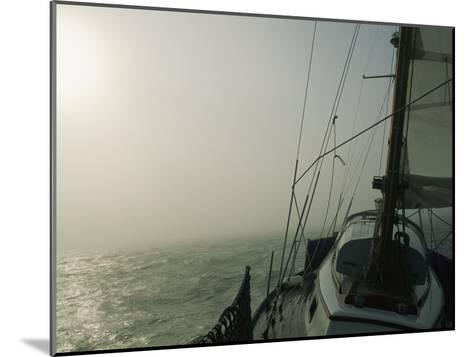 Fog Blankets a Sailboat in San Francisco Bay-Rich Reid-Mounted Photographic Print