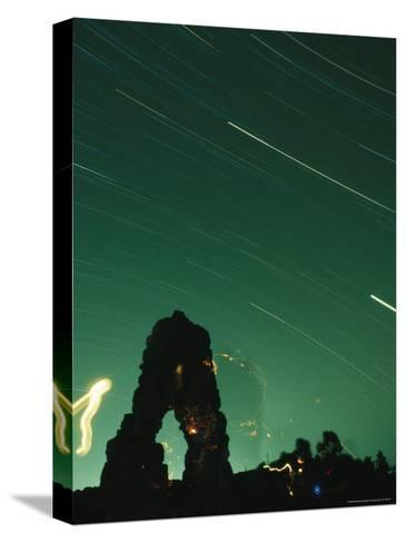 The Silhouette of Knapps Castle during a Meteor Shower--Stretched Canvas Print