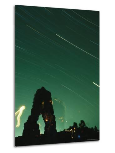 The Silhouette of Knapps Castle during a Meteor Shower--Metal Print